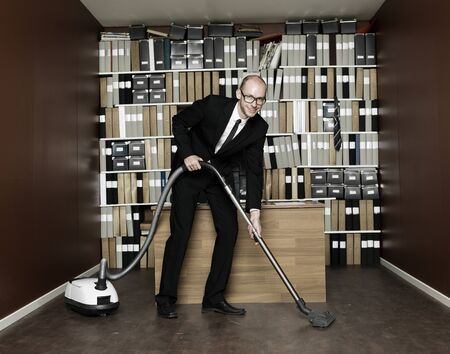 Happy Businessman cleaning the office photo
