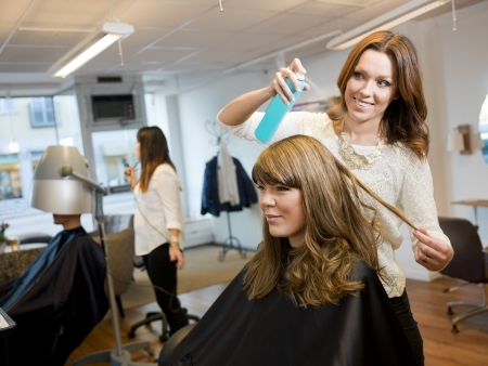 cutting hair: Group of people in a Beauty salon
