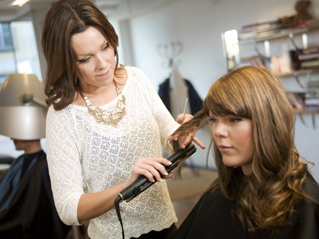 Curling hair at the Beauty salon photo