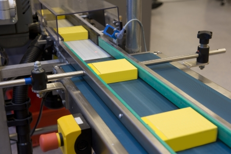 Yellow boxes in production line Standard-Bild