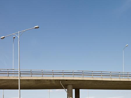 bridged: Highway bridge in front of blue sky Stock Photo