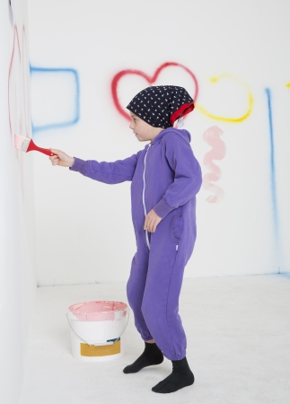 handcarves: Young Girl painting in a white room
