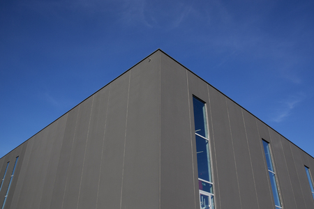 conveyor rail: Warehouse exterior on a sunny day