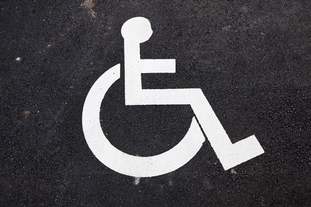 Disabled Sign on asphalt Stock Photo - 24077103