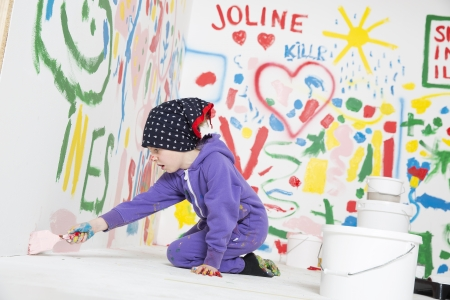Little Girl painting a room