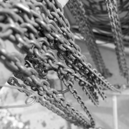 broken unity: Black & White chains with selective focus Stock Photo