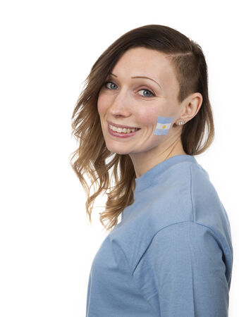 Smiling Girl with the flag of Argentina on her cheek photo
