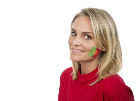 Young Girl with the portuguese flag painted on her cheek photo