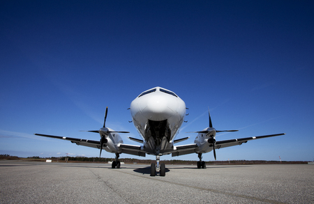 private airplane: Airplane on the ground in front of blue sky