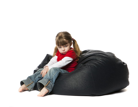 bean bag: Little Girl sitting in a bean bag