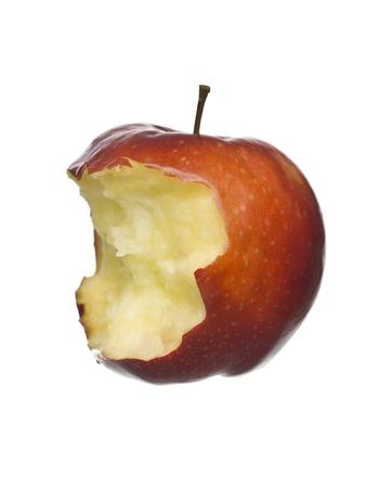 missing bite: Half eaten apple isolated on white background