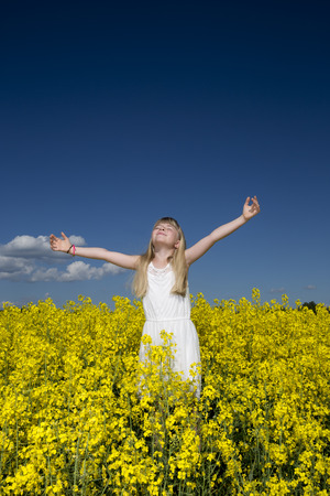 adult rape: Young girl with Outstretched arms on a Rape Field