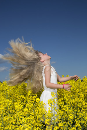 adult rape: Young girl with Long Hair on a Rape Field
