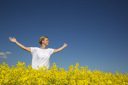 adult rape: Smiling Woman with Outstretched arms on a Rape Field