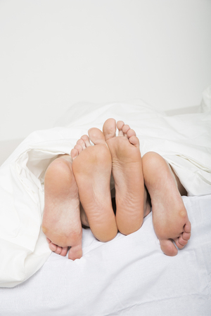 human sexual activity: Married couples feet in bed