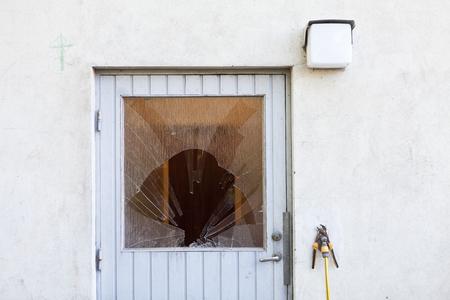 broken house: Broken Window on a door Stock Photo