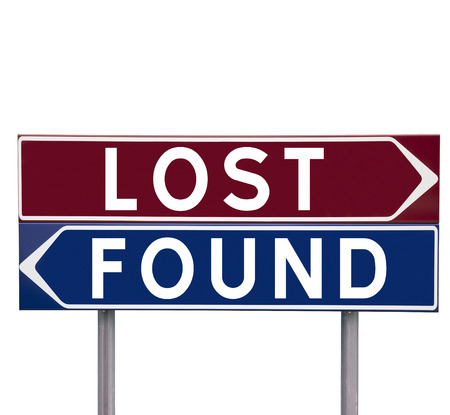 direction signs: Direction Signs with choice between Lost or Found isolated on white background Stock Photo