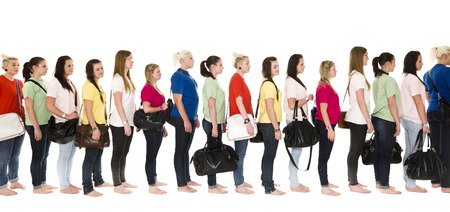 stood up: Girls in colorfull t-shirts in a line on white background Stock Photo