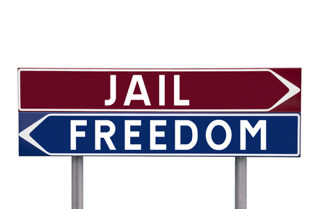 bollard: Direction Signs with choice between Jail or Freedom isolated on white background