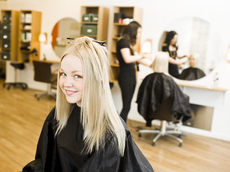 two stroke: Young Blond Girl in the Hair Salon