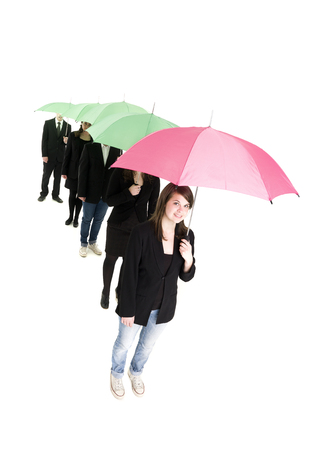 Group of people with umbrellas isolated on white background photo