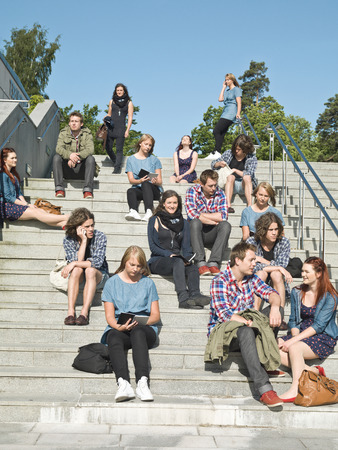Large group of people sitting in the stairs photo