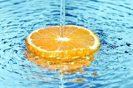 Orange in water splash photo