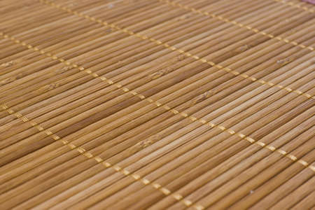 Background bamboo sticks with thread uniting Stock Photo