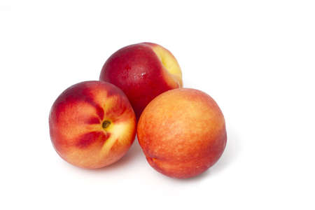 Juicy peaches isolated on white background