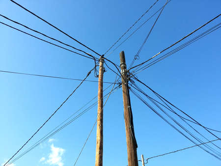 Tangle of electrical cables on a sunny day Stock Photo