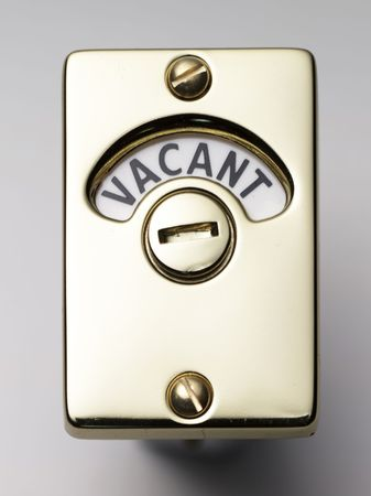 vacant sign: a face on view of a door lock saying vacant    Stock Photo