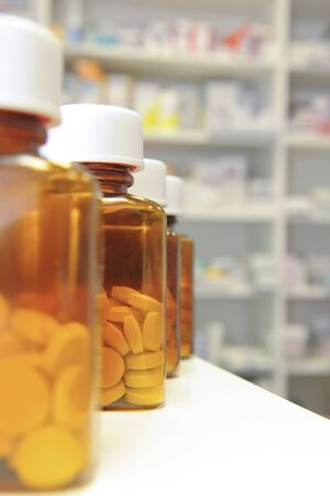 row of bottles and pills on a chemists counter Stock Photo