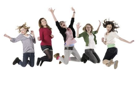Five teenage girls jumping in the air against white background