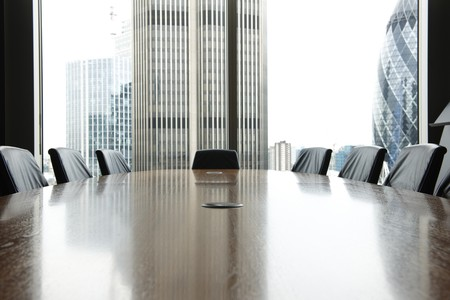 view of boardroom table with chairs and city buildings in background Stock Photo - 8006881