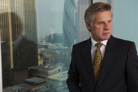 Portrait of a senior executive by a window  looking off camera