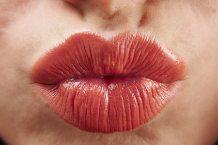 close up of womans pouting lips with red lipstick Stock Photo - 9873600