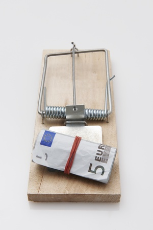 elastic band: several euro bills with elastic band  set on a mouse-trap Stock Photo