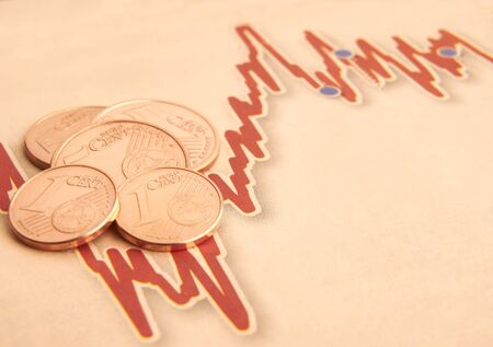 stock market graph: Euro coins on fluctuating graph with space for copy