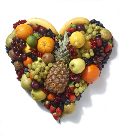 Overhead view of vaus types of fruit in heart shape on white background Stock Photo - 12681392