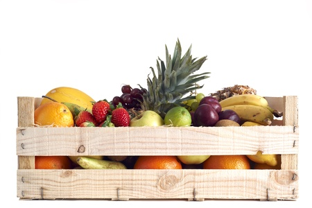 Various types of fruit stored in wooden box on white background