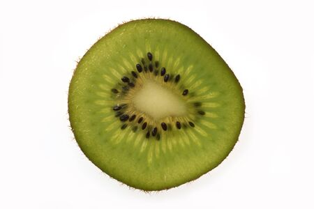 Overhead view of slice of kiwi fruit on plain background Stock Photo - 12681393