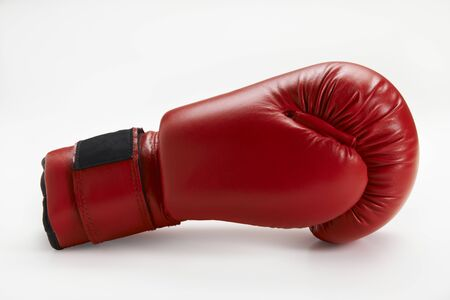 single red boxing glove isolated on white background Stock Photo