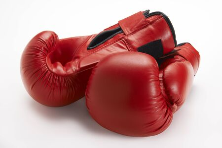 Pair of red boxing gloves isolated on white background photo
