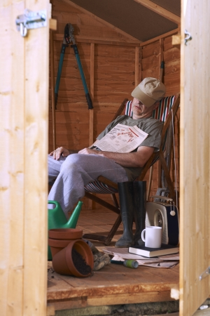 Man sitting in deckchair falling asleep in the shed Stock Photo - 18635710
