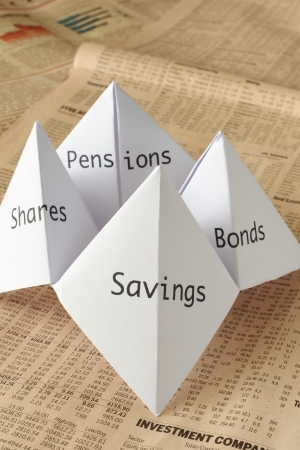 share prices: origami fortune teller on financial paper showing share prices Stock Photo