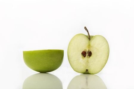 Studio shot of green apple cut in half showing seeds Stock Photo