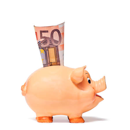 50 euro: Piggy Bank with 50 Euro note isolated on white background