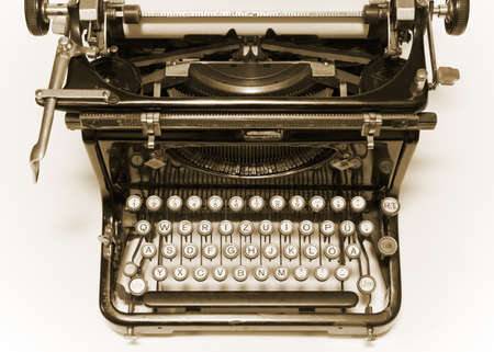 Old type writer with paper sheet photo