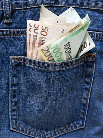 Bunch of Euro banknotes in the back pocket of a blue jeans. photo