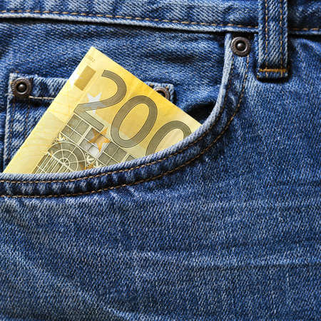 100 euro note in a blue jeans pocket  photo
